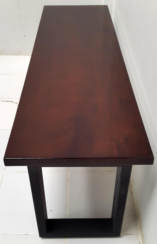 dark brown wooden table with black iron legs