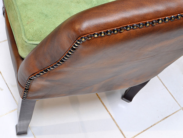vintage leather restaurant seat with velvet cushion