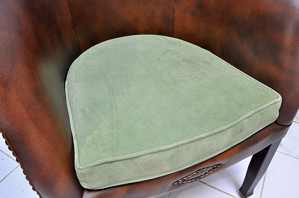vintage leather restaurant seat with green velvet cushion