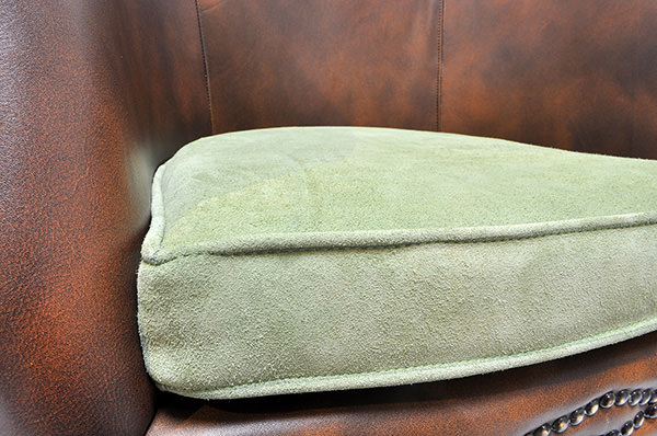 vintage brown leather restaurant seat with green velvet cushion
