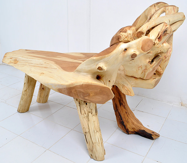 teak root bench with natural shapes and light finishing