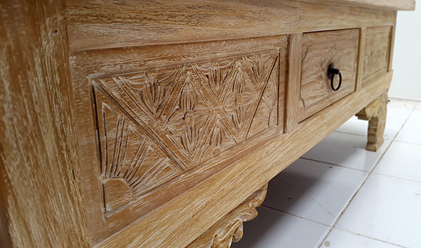 carved traditional teak coffee table with a drawer