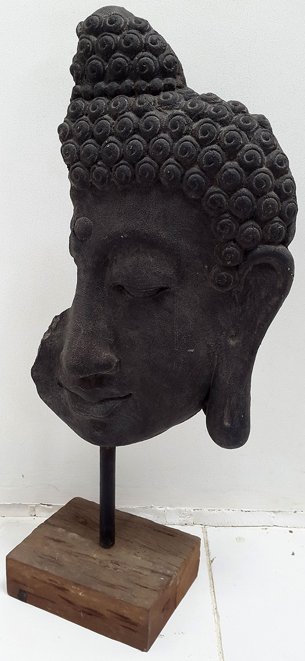 black stone sculpture face