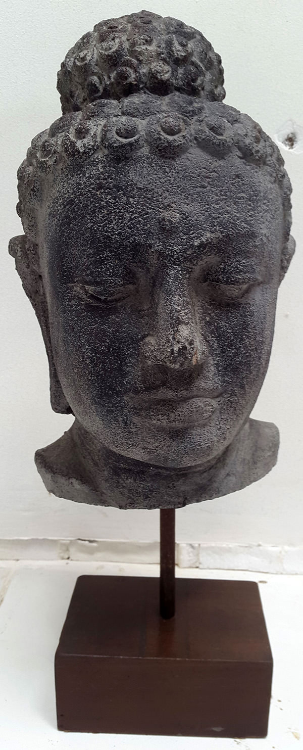 standing black stone sculpture face