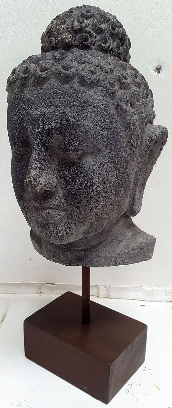 standing black stone sculpture buddha face