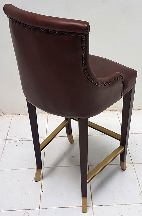 antique leather bar chair with brass foot rest