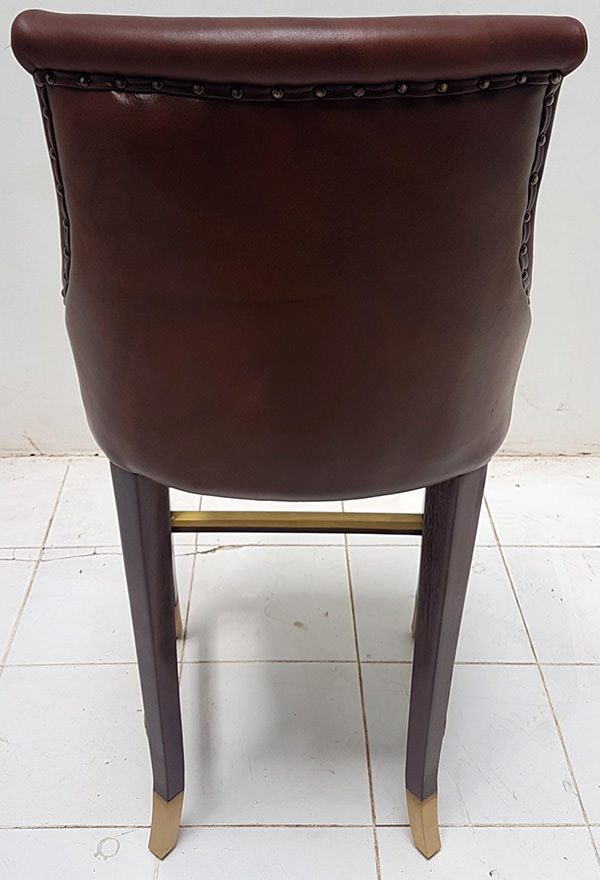 leather dining chair with gold brass foot rest