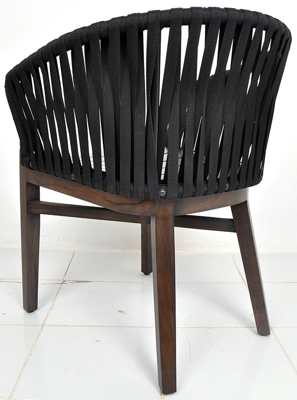 curved outdoor chair with teak seat and black ropes backseat