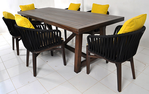 outdoor Scandinavian dining chair with seat cushion for restaurant and yellow throwing pillow