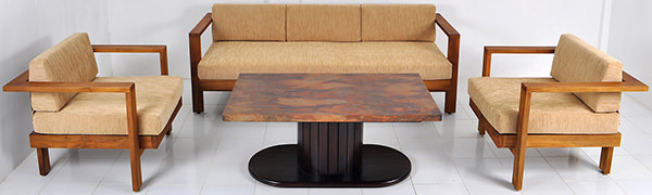 teak and linen sofa with copper coffee table