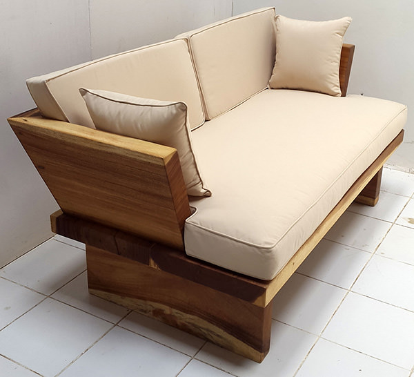 suar wood sofa with white mattress and two throwing pillows