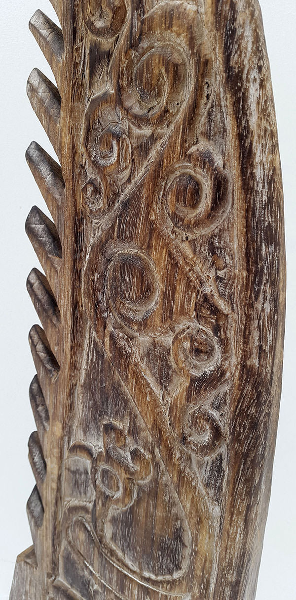 standing ethnic wooden fin