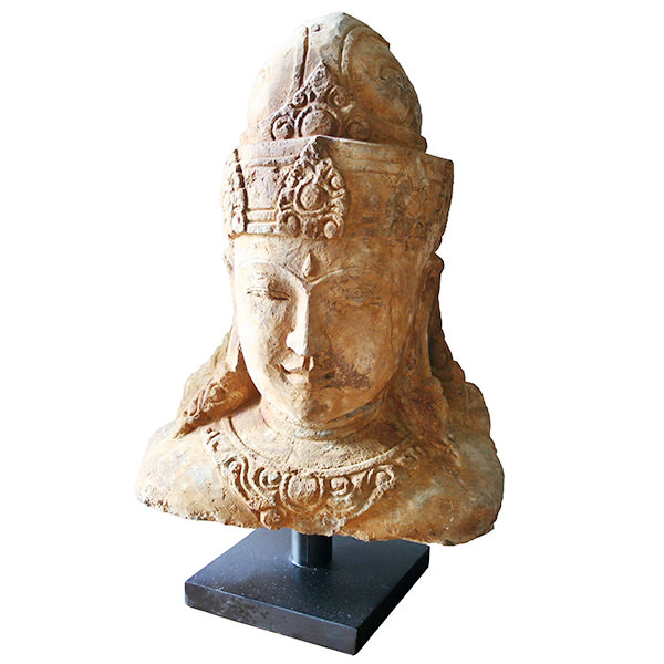 stone sculpture of krishna head