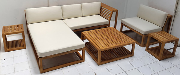 Teak L-shaped sofa with white mattress and square coffee table