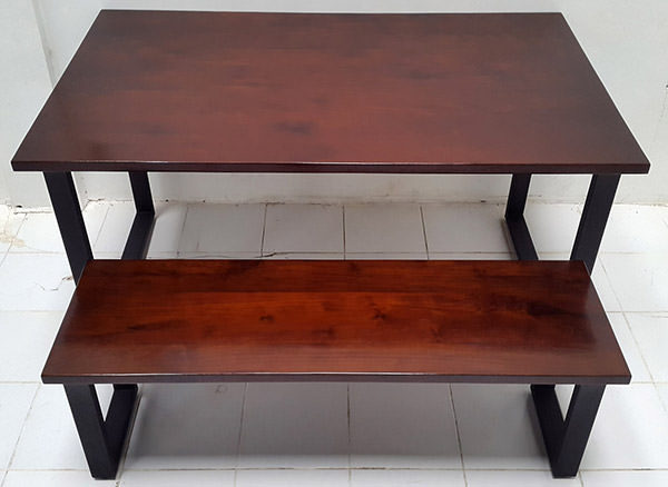 wood and iron table and bench set