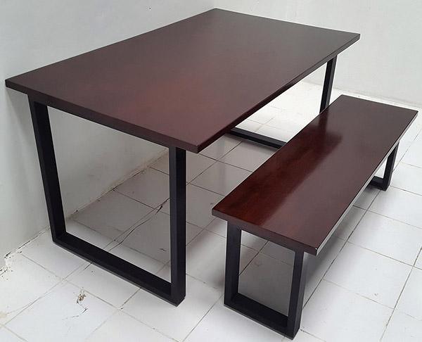 dark brown mahogany table and bench